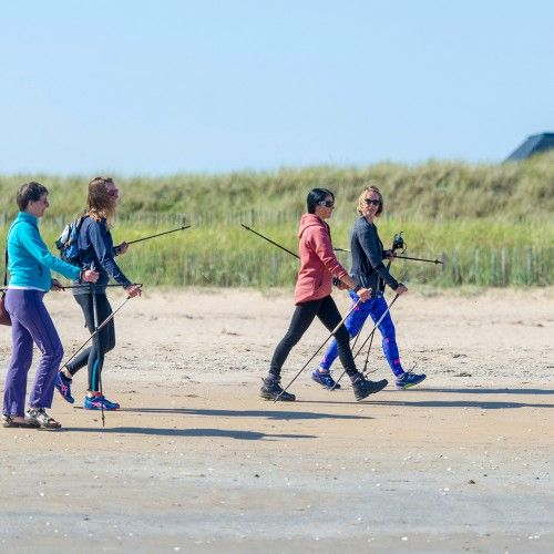Courier Features - Out and About - Gayle Ritchie story; CR0003424 Gayle joins a Nordic Walking session with Sam Mace who runs The View Studio in St Andrews (loads of yoga and pilates classes. etc) Pics of the class (there might be some mums with babies in slings) marching along the beach at West Sands. Picture Shows; l to r - Helen Kermode, Claire McIntyre, Gayle and Sam Mace (instructor), West Sands, St Andrews, Friday 31st August 2018